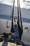Sailing yacht rigging equipment: main sheet traveller block closeup Royalty Free Stock Photography