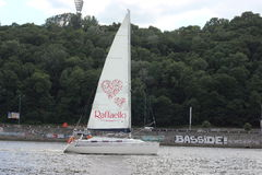 Sailing yacht on the river. Advertising campaign of Raffaello on a sailing ship. Dnepr River. Kiev. Ukraine stock photo