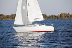 Sailing yacht at the river bank in autumn Stock Photos