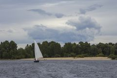 Sailing yacht on the river Dnipro in the water area of Kyiv. Ukraine royalty free stock images