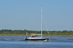 Sailing yacht on river Royalty Free Stock Photos