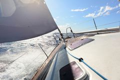 A sailing yacht sailing on the blue sea during sunny wheather Royalty Free Stock Photos