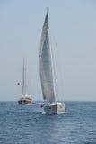 Sailing yacht and sailing ship at sea stock photos