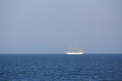 Sailing yacht at sea. A sailing yacht at sea, under a clear sky Stock Image