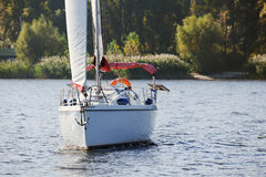 Sailing yacht at the shore in autumn Royalty Free Stock Images
