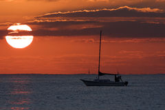 Sailing Yacht silhouetted against the sunrise Royalty Free Stock Photos
