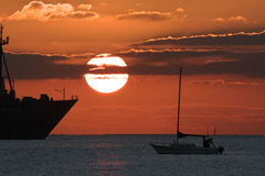 Sailing Yacht silhouetted against the sunrise Stock Photos