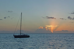 Sailing yacht and sunrise on the Pacific Ocean Royalty Free Stock Images