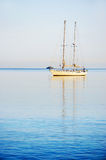 Sailing Yacht at sunrise Stock Images