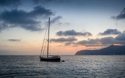 Sailing yacht at sunset Royalty Free Stock Photo