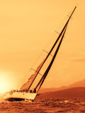 sailing yacht at sunset Royalty Free Stock Images