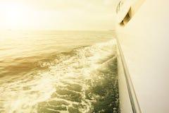 Sailing yacht in sunset Stock Photos