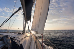 Sailing on yacht in to the sun Royalty Free Stock Images