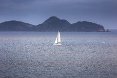 Sailing yacht with white sails in the open sea Royalty Free Stock Image