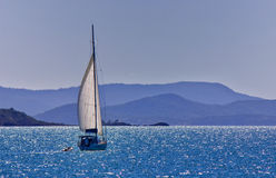 Sailing a yacht in the Whitsundays. Queensland, Australia Royalty Free Stock Photo
