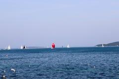 Sailing yachts and blue sea stock photos