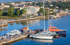 Sailing yachts and boats are moored in port Stock Photography