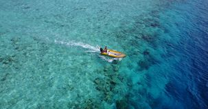 V10187 sailing yachts and boats with view from aerial flying drone in clear aqua blue sea water and blue sky Stock Photos