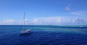 V10236 sailing yachts and boats with view from aerial flying drone in clear aqua blue sea water and blue sky. Sailing yachts and boats with view from aerial stock image