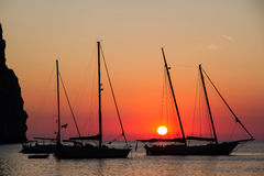 Sailing yachts in Cala Sa Calobra at sunset Stock Photos
