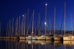 Sailing Yachts in Harbor. Multiple yachts in the harbor at night Stock Images