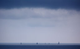 Sailing yachts, Juean-les-Pins, France. Sailing yachts racing under a leaden sky, Juan les Pins, France Stock Photo