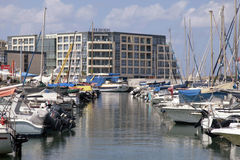 Sailing yachts and modern buildings in Herzliya Marina, Israel. Stock Photography