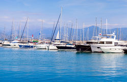 Sailing yachts and motorboats in marina Royalty Free Stock Image