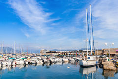 Sailing yachts and motorboats in marina Royalty Free Stock Photos