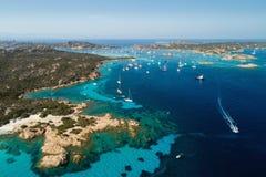 Sailing yachts near islands between Sardinia and Corsica. Aerial view of sailing yachts near islands between Sardinia and Corsica stock images
