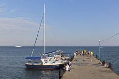 Sailing yachts at the pier on Gorky Embankment in Evpatoria, Crimea royalty free stock photography