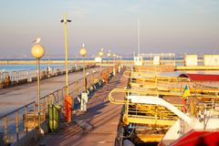 Sailing yachts and pleasure boats stand moored in port. Selective focus royalty free stock photography