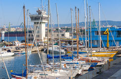 Sailing yachts and pleasure boats stand in port of Varna Stock Images