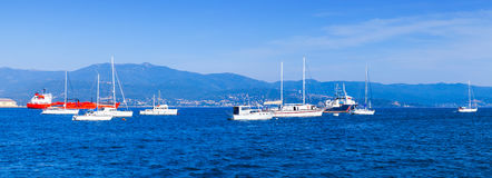 Sailing yachts and pleasure motorboats. Moored in bay of Ajaccio, Corsica, France. Panoramic photo Stock Photos