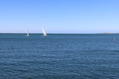 Sailing yachts in Port Phillip Bay at the Geelong waterfront royalty free stock images