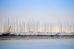 Sailing yachts. Sunrise above marina with sailing yachts in row. Piraeus, Greece stock image