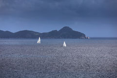 Sailing yachts with white sails in the open sea Stock Photography