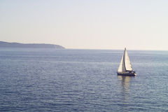 Sailingboat. A Sailing boat with island in the background Royalty Free Stock Images