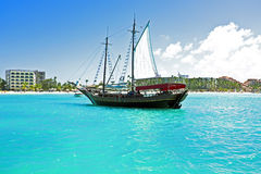 Sailingboat anchoring in the Caribbean Stock Images