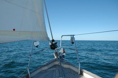 Sailingboat on open sea. Boat on open sea Royalty Free Stock Image