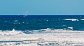 Sailinig in the rough sea Stock Photography