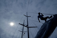 Sailor. Working on the sail boat at night stock photography