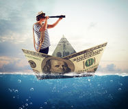 Sailor on banknote boat Royalty Free Stock Photography
