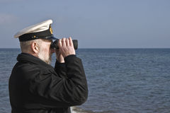 Sailor with Binoculars. Observing the sea in calm weather royalty free stock images