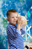 Sailor Boy. In sea with flag stock photo