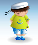 A sailor boy in a white naval hat, a green T-shirt with a painted anchor. Recreation, marine theme. A sailor boy in a white naval hat, a green T-shirt with a Royalty Free Stock Photography