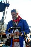 Sailor decorated with ancient garment. On an old sailboat to explain to tourists the history of naviguation Stock Photo