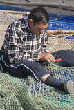 Sailor fixed their fishing nets in the port of Estepona Stock Photography