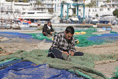 Sailor fixed their fishing nets in the port of Estepona Royalty Free Stock Photo