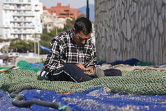 Sailor fixed their fishing nets in the port of Estepona Stock Photos